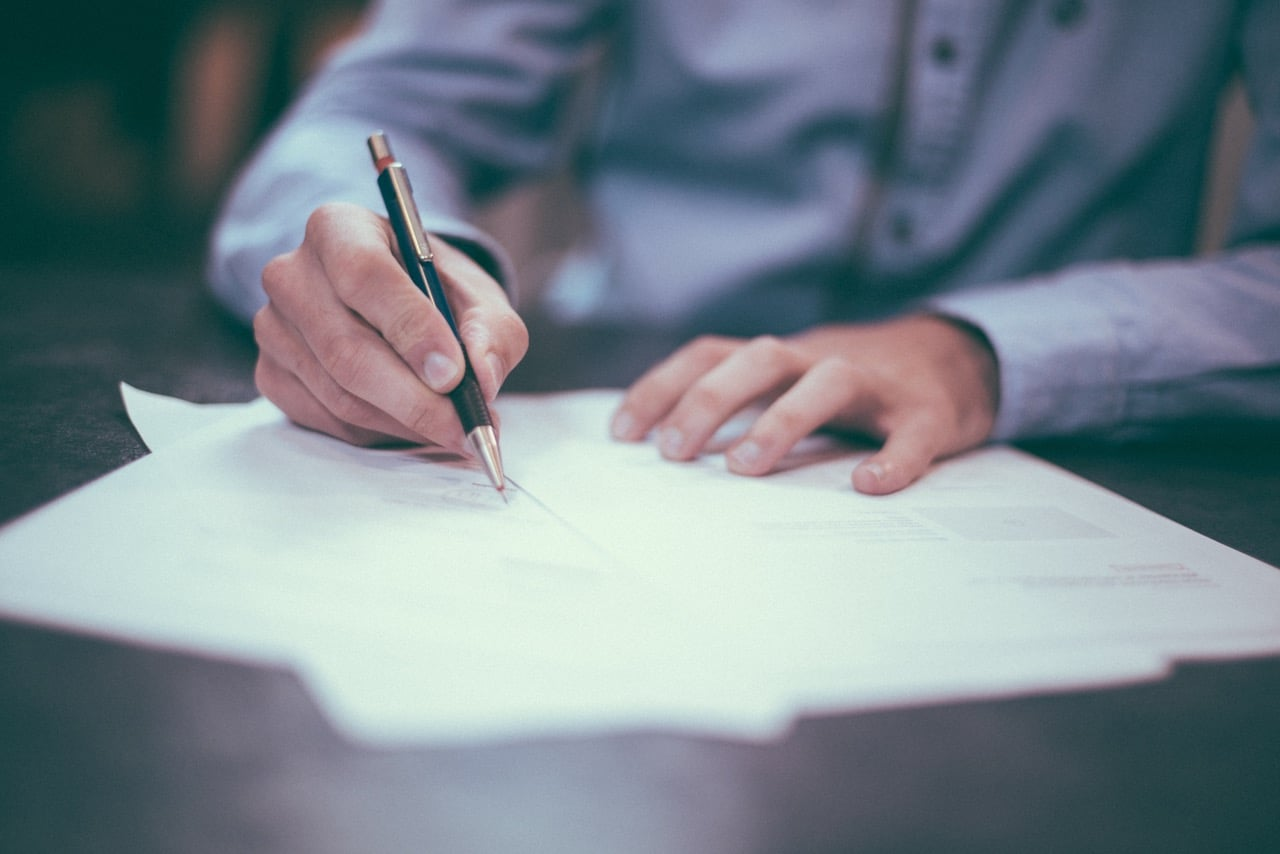 Man filling out bankruptcy papers