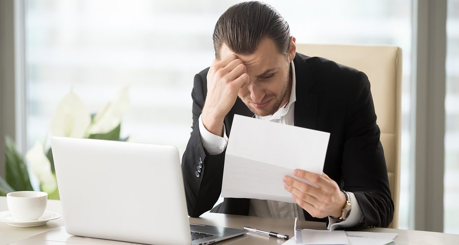 Man holding a paper to file bankruptcy